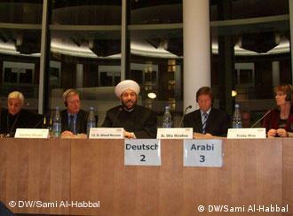 المفتي السوري اثناء محاضرته في البرلمان الألماني