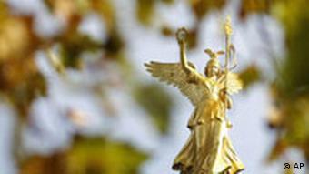Berlin's Victory Column seen through the trees