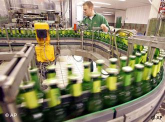 Bottles of beer being sorted on an assembly line