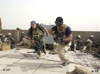 Plainclothes contractors working for Blackwater USA take part in a firefight in Iraq