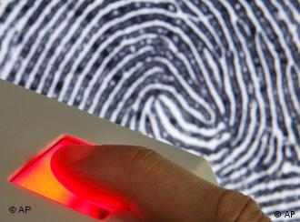 A fingerprint reader scans a person's finger