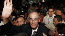 Alvaro Colom greets supporters after winning Guatemala's presidential elections in Guatemala City, Sunday, Nov. 4, 2007. Colom beat retired Gen. Otto Perez Molina who conceded defeat after results from 95 percent of the vote showed him trailing Colom by 6 percentage points. (AP Photo/Esteban Felix)
