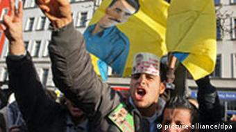 Kurdish protesters in Berlin waving flags of Ocalan