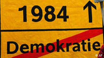 A sign reading Democracy (crossed out) and 1984