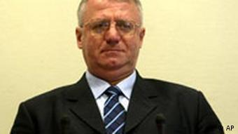 Vojislav Seselj.jpg ** FILE ** Serbian ultranationalist Vojislav Seselj is seen during his initial appearance at the Yugoslav war crimes tribunal in The Hague, Netherlands, in this Feb. 26, 2003 file photo. The top Serb opposition leader went on trial Wednesday Nov. 7, 2007 at the U.N. war crimes tribunal on charges that he inflamed ethnic tensions and incited Serb paramilitaries to carry out atrocities during Yugoslavia's bloody breakup. Seselj _ chairman of the nationalist Serbian Radical Party, Serbia's main opposition party _ is one of the most senior political figures in custody at the tribunal. (AP Photo/Toussaint Kluiters, Pool)