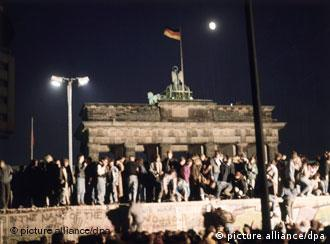 Germans standing on the Berlin Wall, November 9, 1989