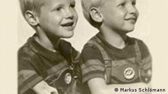 Two young german boys, one with shortened arms from thalidomide, the other one with normal arms