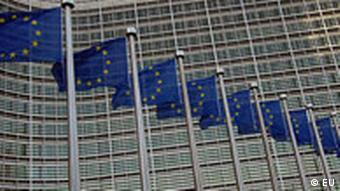 European flags in front of the Berlaymont building, headquarter of the European Commission