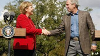 Bush and shake hands at his ranch in Crawford, Texas
