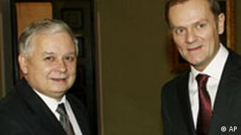 Poland's President Lech Kaczynski, left, greets Prime Minister-designate Donald Tusk, right