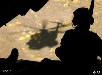 Silhouette of a soldier and helicopter