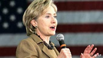 Hillary Clinton speaks in front of an American flag