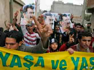 Supporters of the pro-Kurdish Democratic Society Party demonstrating in 2007 with a banner that reads live and let live