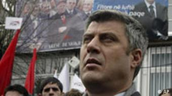 Main opposition leader Hashim Thaci attends the closing rally of Democratic Party of Kosovo (PDK) in northern Kosovo town of Podujevo on Thursday, Nov. 15, 2007. Local and parliamentary elections are scheduled for November 17, even though Kosovos legal status remains undefined, and negotiations between the governments of Serbia and Kosovo to solve this issue are continuing. Banner of the late Kosovo President Ibrahim Rugova is seen in background.(AP Photo/Visar Kryeziu)
