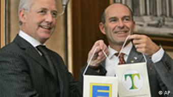 Head of Tengelmann Karl-Eriwan Haub , right, and the chairman of Edeka Alfons Frenk, left.