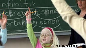 An albino girl at a school for visually impaired in Cologne; her eyes are very light sensitive