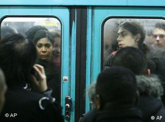 Passengers are seen in an overcrowded subway train in Paris, Wednesday Nov. 21, 2007. Long-awaited negotiations with striking transit workers began Wednesday, the eight full day of the walkout that has paralyzed train traffic throughout the country. (AP Photo/Jacques Brinon)