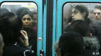 Passengers are seen in an overcrowded subway train in Paris