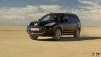 An SUV in the desert
