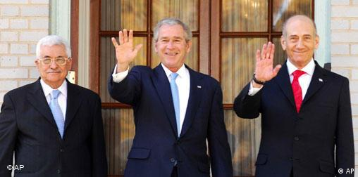 President George Bush with Palestinian President Mahmoud Abbas, left, and Israel's Prime Minister Ehud Olmert, right during their meeting in Annapolis in 2007
