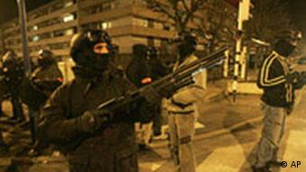 Policeman holding a rifle in Paris suburb