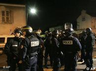 Riot policemen patrol Villiers-le-Bel