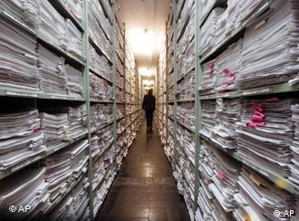 A man going throught the records at the ITS archive