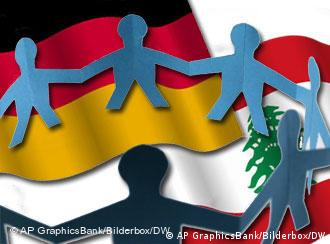 symbolic image of cooperation between germany and lebanon with paper cut out of figures linking hands and national flags in background