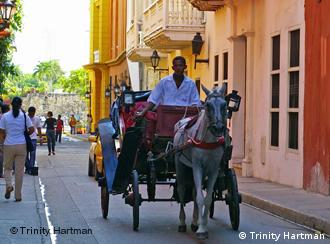 A horse-drawn carriage rides through the center of Cartagena, Colombia. A showcase for colonial architecture