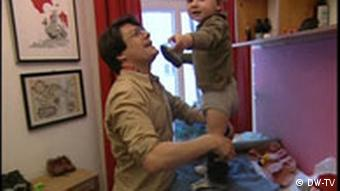 A father getting a child dressed