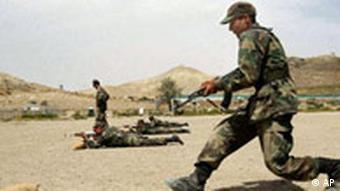 An Afghan National Army soldier runs to take a position during a training
