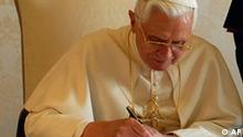 In this photo released by the Vatican's L'Osservatore Romano newspaper, Pope Benedict XVI signs his second encyclical document Spe Salvi (Saved by Hope) as Bishop Fernando Filioni, right, looks on, at the Vatican, Friday Nov. 30, 2007. Benedict XVI strongly criticized modern-day atheism in the major document released Friday, saying it had led to some of the greatest forms of cruelty and violations of justice'' ever known to mankind. (AP Photo/L'Osservatore Romano, HO)