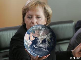Angela Merkel holding a globe in her hand