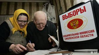 Two elderly Russians look at ballot forms
