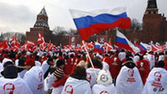a rally of Naschi youth waving a Russian flag