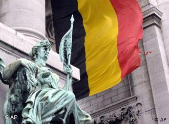 Belgian flag behind statue