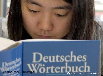 A woman reads a German dictionary