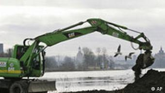 A bulldozer beginning construction on the bridge last November