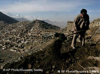A man working to repair a path on a hill above Kabul