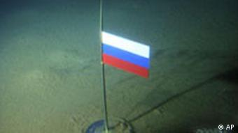 A titanium capsule with the Russian flag is seen under the North Pole