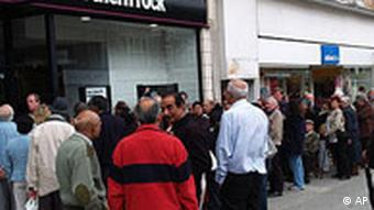 A Monday Sept. 17, 2007 photo showing customers standing in a queue outside a branch of the Northern Rock the British mortgage lender in Harrow, London. Shares of British mortgage lender Northern Rock PLC, hit by a liquidity crisis which sent customers lining up to withdraw billions in deposits, tumbled more than 30 percent Monday Sept. 17. Britain's first bank run in almost a century has prompted the government Monday Oct. 15, 2007, to take a cue from the U.S. response to the Great Depression and promise laws that will automatically guarantee savings and quick compensation in the event of a bank collapse. Critics, however, suggest that such a knee-jerk political decision could incur significant insurance costs for banks, especially for smaller financial institutions _ a cost that will likely be passed on to customers via higher charges.(AP Photo/ Max Nash)