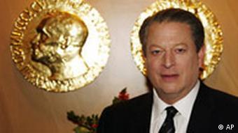 Man in suit standing beside gold plaque