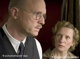 An image of the two actors in a scene from John Rabe
