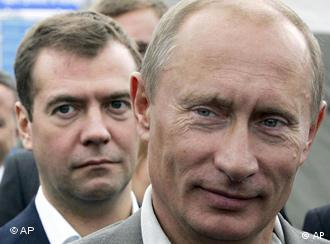 Russian President Vladimir Putin, right, and First Deputy Prime Minister Dmitry Medvedev