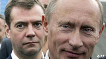 Russian President Vladimir Putin, right, and First Deputy Prime Minister Dmitry Medvedev, background