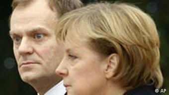 German Chancellor Angela Merkel, right, and Polish Prime Minister Donald Tusk listen to the national anthems during the welcoming ceremony at the Chancellery in Berlin, Tuesday, Dec. 11, 2007. Tusk is on his first visit to Germany after his election as Prime Minister. (AP Photo/Markus Schreiber)