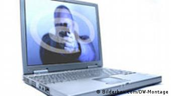 A computer, with a man holding a gun on the screen