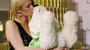 Paris Hilton kissing Knut doll