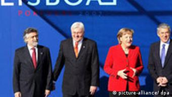 Portuguese Prime Minister and EU President, Jos- Súcrates, together with Portuguese Foreign Afffairs Minister, Luis Amado, German Federal Chancellor, Angela Merkel, and German Foreign Affairs Minister, Frank-Walter Steinmeier, at the signing ceremony of the Treaty of Lisbon at the Jeronimos Monastery, in Lisbon, Portugal, 13 December 2007.