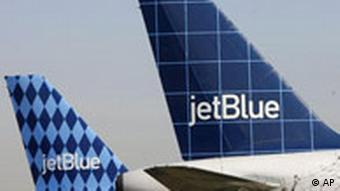 A JetBlue plane parked at JFK airport.